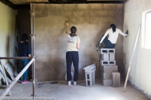 Danni, Peixi and Jemma sanding down the walls inside so that they could be painted.