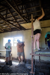 Mark, Bill and Jessa helping Sia to put up the ceiling boards.