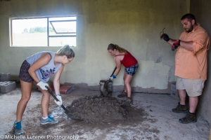 Caitlin, Kimberly and Bill mixing concrete, the old fashioned way - by hand!!!