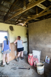 Jess and Georgia helping Franz with the plastering